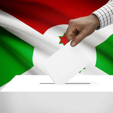 electoral system: Ballot box with flag on background - Burundi Stock Photo