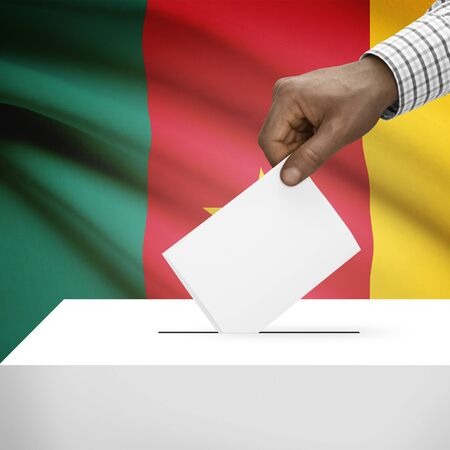 Ballot box with flag on background - Cameroon photo