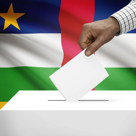 electoral system: Ballot box with flag on background - Central African Republic