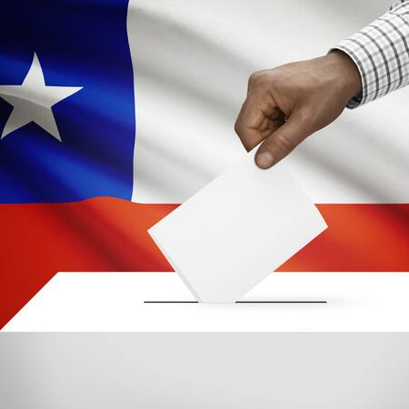 electoral system: Ballot box with flag on background - Chile Stock Photo