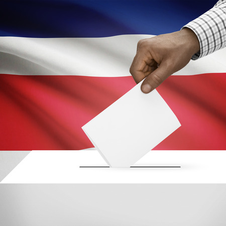 electoral system: Ballot box with flag on background - Costa Rica