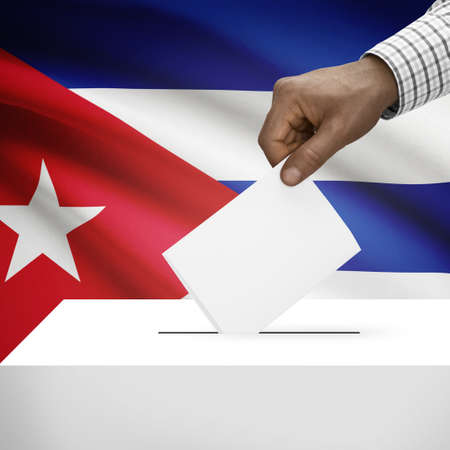 Ballot box with flag on background - Cuba photo