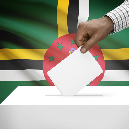 local election: Ballot box with flag on background - Dominica