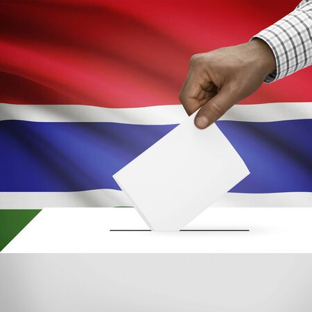 polling booth: Ballot box with flag on background - Gambia Stock Photo
