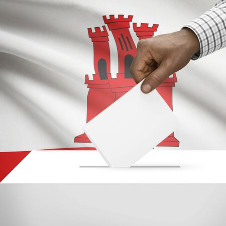 local election: Ballot box with flag on background - Gibraltar