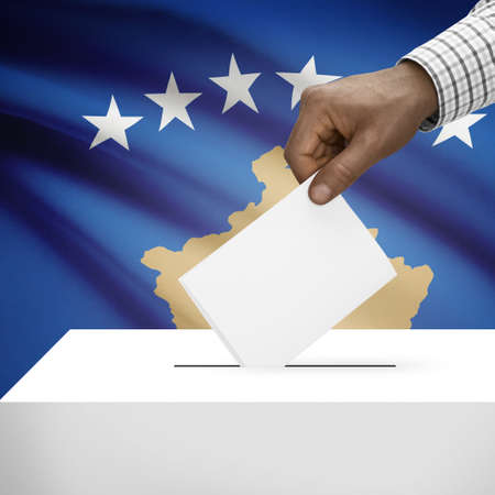 electoral system: Ballot box with flag on background - Kosovo