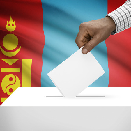electoral system: Ballot box with flag on background - Mongolia