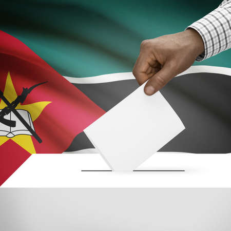 electoral system: Ballot box with flag on background - Mozambique Stock Photo