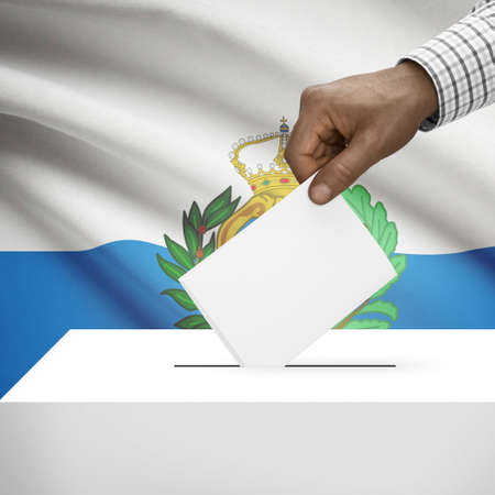electoral system: Ballot box with flag on background - San Marino Stock Photo