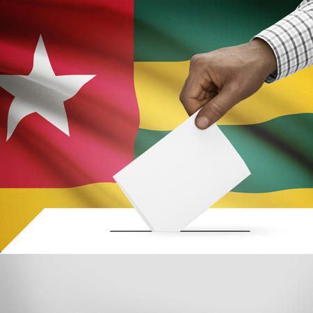 local election: Ballot box with flag on background - Togo Stock Photo