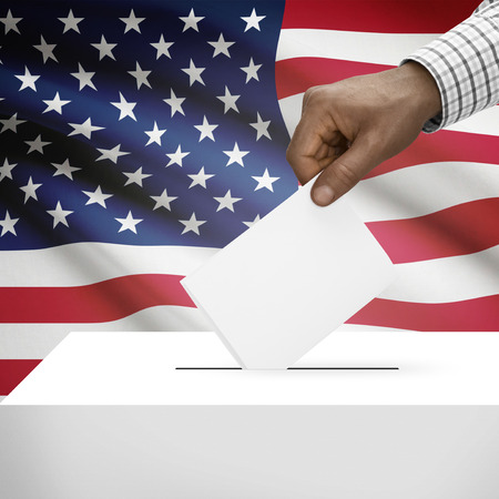 electoral system: Ballot box with flag on background - United States of America