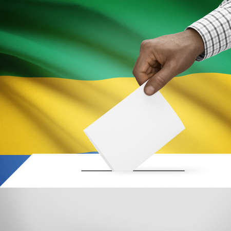 electoral system: Ballot box with flag on background - Gabon
