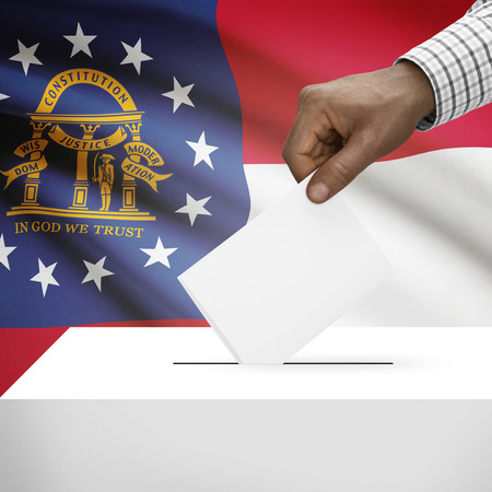 electoral system: Ballot box with US state flag on background - Georgia