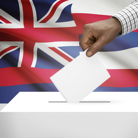 electoral system: Ballot box with US state flag on background - Hawai Stock Photo