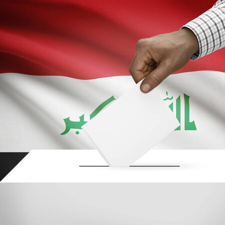 electoral system: Ballot box with flag on background - Iraq