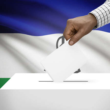 polling booth: Ballot box with flag on background - Lesotho Stock Photo