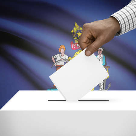 local election: Ballot box with US state flag on background - Maine