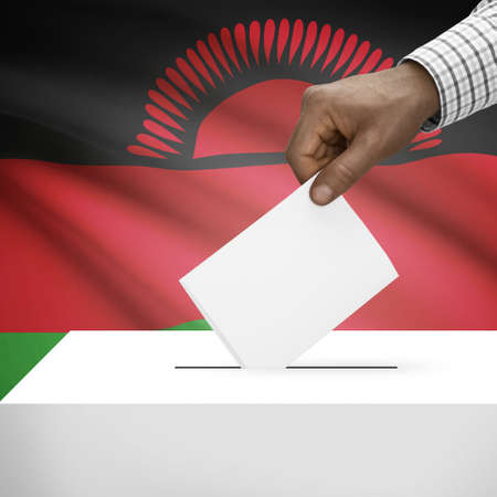 electoral system: Ballot box with flag on background - Malawi Stock Photo