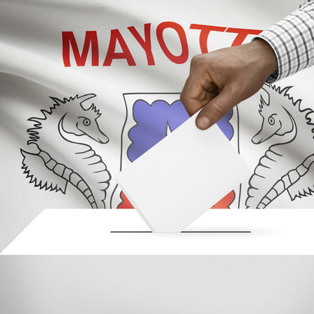 mayotte: Ballot box with flag on background - Department of Mayotte