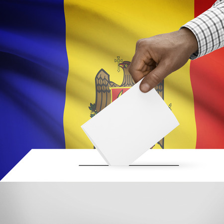 electoral system: Ballot box with flag on background - Moldova