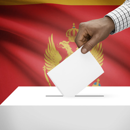 electoral system: Ballot box with flag on background - Montenegro