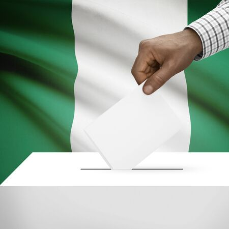polling booth: Ballot box with flag on background - Nigeria Stock Photo