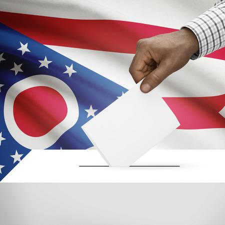 Ballot box with US state flag on background - Ohio photo