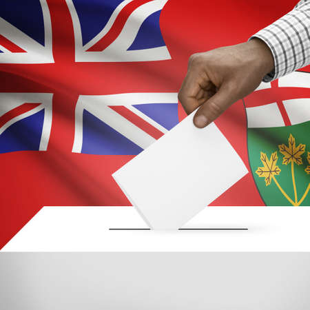 electoral system: Ballot box with Canadian province flag on background - Ontario