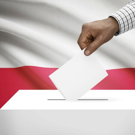 electoral system: Ballot box with flag on background - Poland Stock Photo