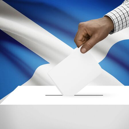 electoral system: Ballot box with flag on background - Scotland Stock Photo