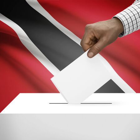 electoral system: Ballot box with flag on background - Trinidad and Tobago Stock Photo