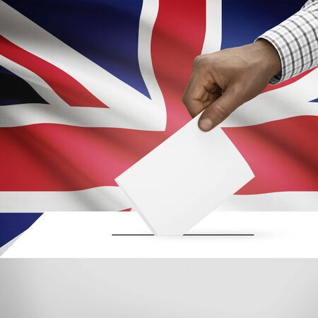 electoral system: Ballot box with flag on background - United Kingdom