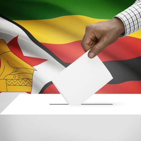 Ballot box with flag on background - Zimbabwe photo