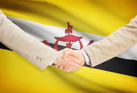 Businessmen shaking hands with flag on background - Brunei Stock fotó