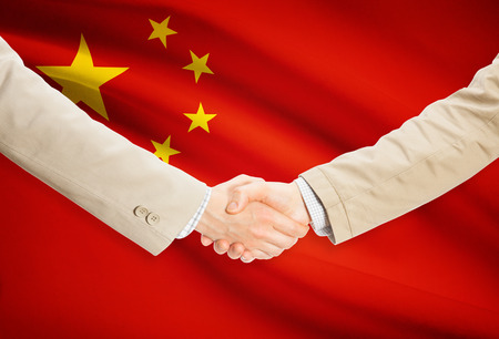Businessmen shaking hands with People's Republic of China flag on background Reklamní fotografie - 39820001