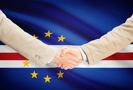cape verde flag: Businessmen shaking hands with Cape Verde flag on background