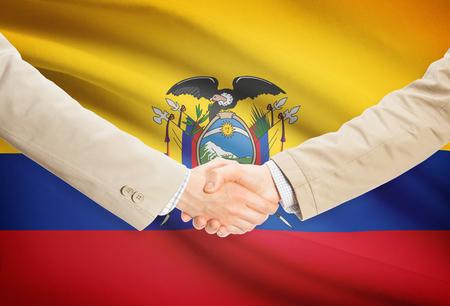 ecuadorian: Businessmen shaking hands with Ecuador flag on background Stock Photo