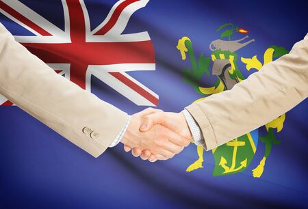 pitcairn: Businessmen shaking hands with Pitcairn Island flag on background