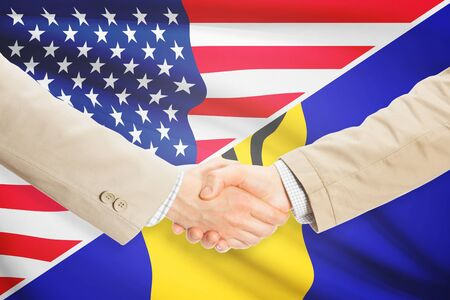 barbadian: Businessmen shaking hands - United States and Barbados