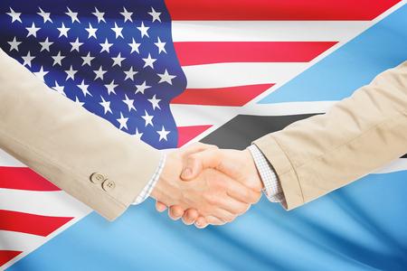 botswanan: Businessmen shaking hands - United States and Botswana