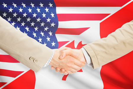 canada flag: Businessmen shaking hands - United States and Canada