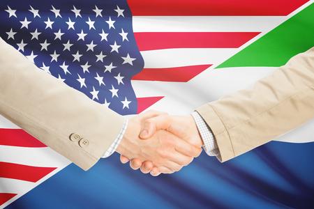 sierra leone: Businessmen shaking hands - United States and Sierra Leone