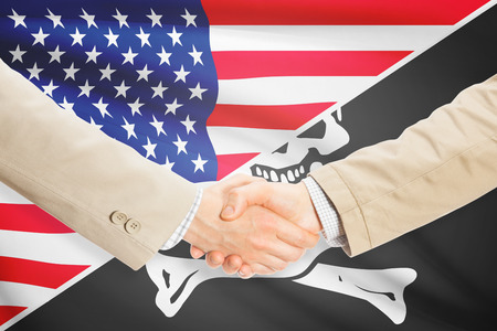 jolly roger: Businessmen shaking hands - United States and Jolly Roger Stock Photo
