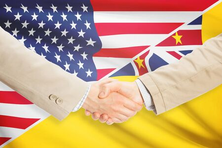 niue: Businessmen shaking hands - United States and Niue Stock Photo