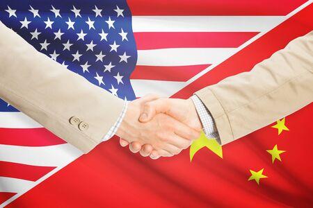 china business: Businessmen shaking hands - United States and China Stock Photo