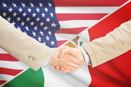 mexican flag: Businessmen shaking hands - United States and Mexico Stock Photo
