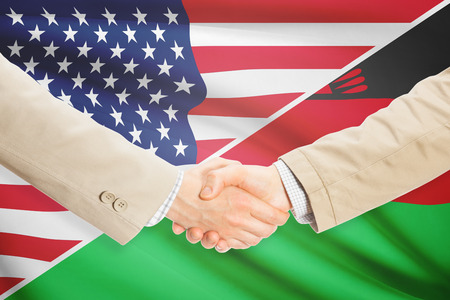 malawian: Businessmen shaking hands - United States and Malawi