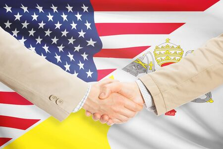 vatican city: Businessmen shaking hands - United States and Vatican City