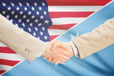 micronesia: Businessmen shaking hands - United States and Micronesia