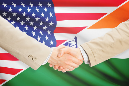 Businessmen shaking hands - United States and India Stock Photo